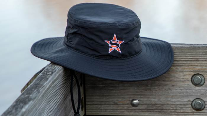 Shademaker II bucket hat sitting on porch rail