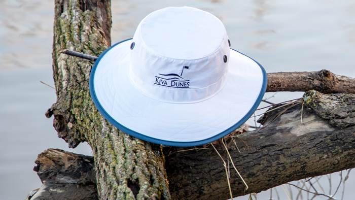 Shademaker I bucket hat sitting on fallen tree branch