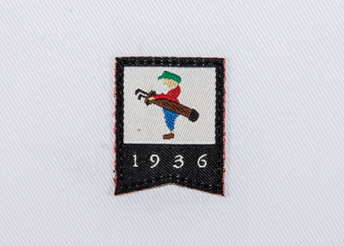 Pukka beanie label shape, banner and date with jump stitch