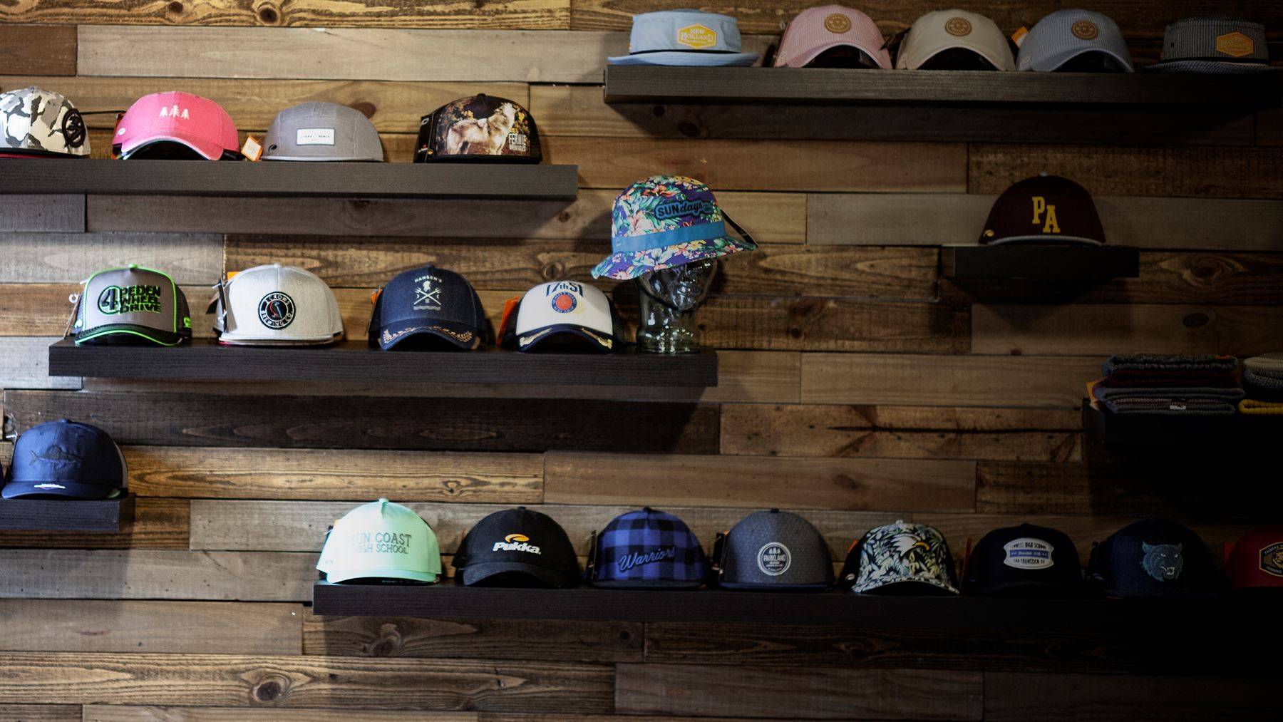 Wall of shelves with hats