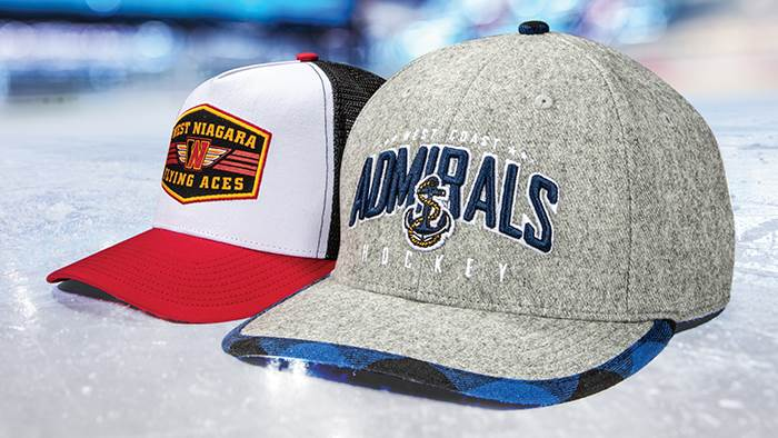 A pair of hockey hats on a ice rink