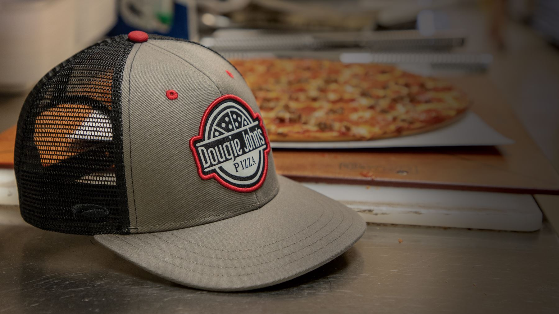 Hat sitting with pizza on work surface