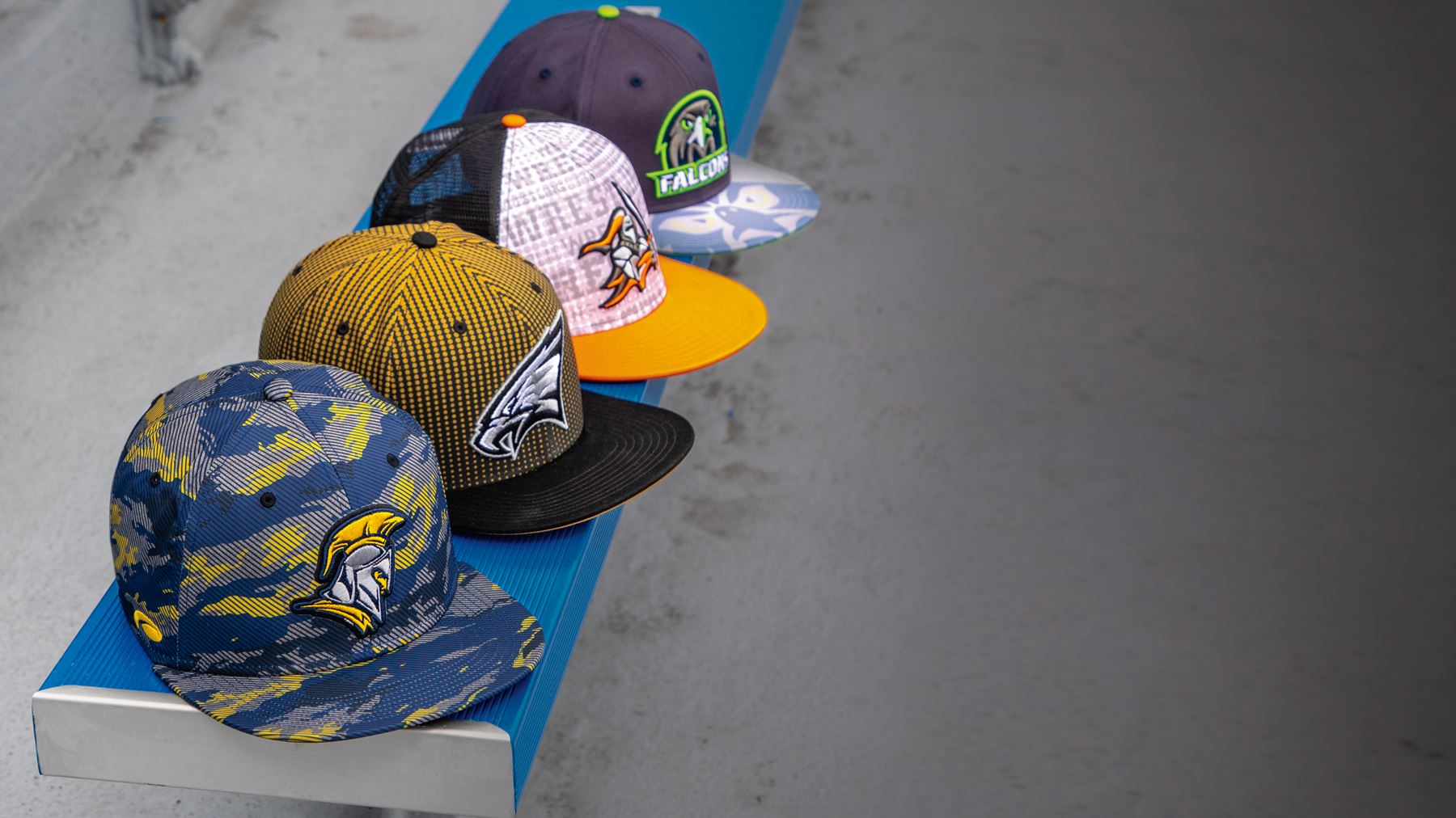 Pukka Hats lined up on a bench