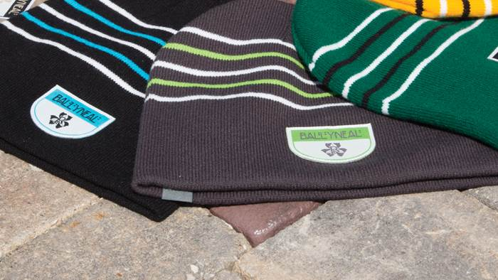 Cold Weather beanies laying on stone and brick