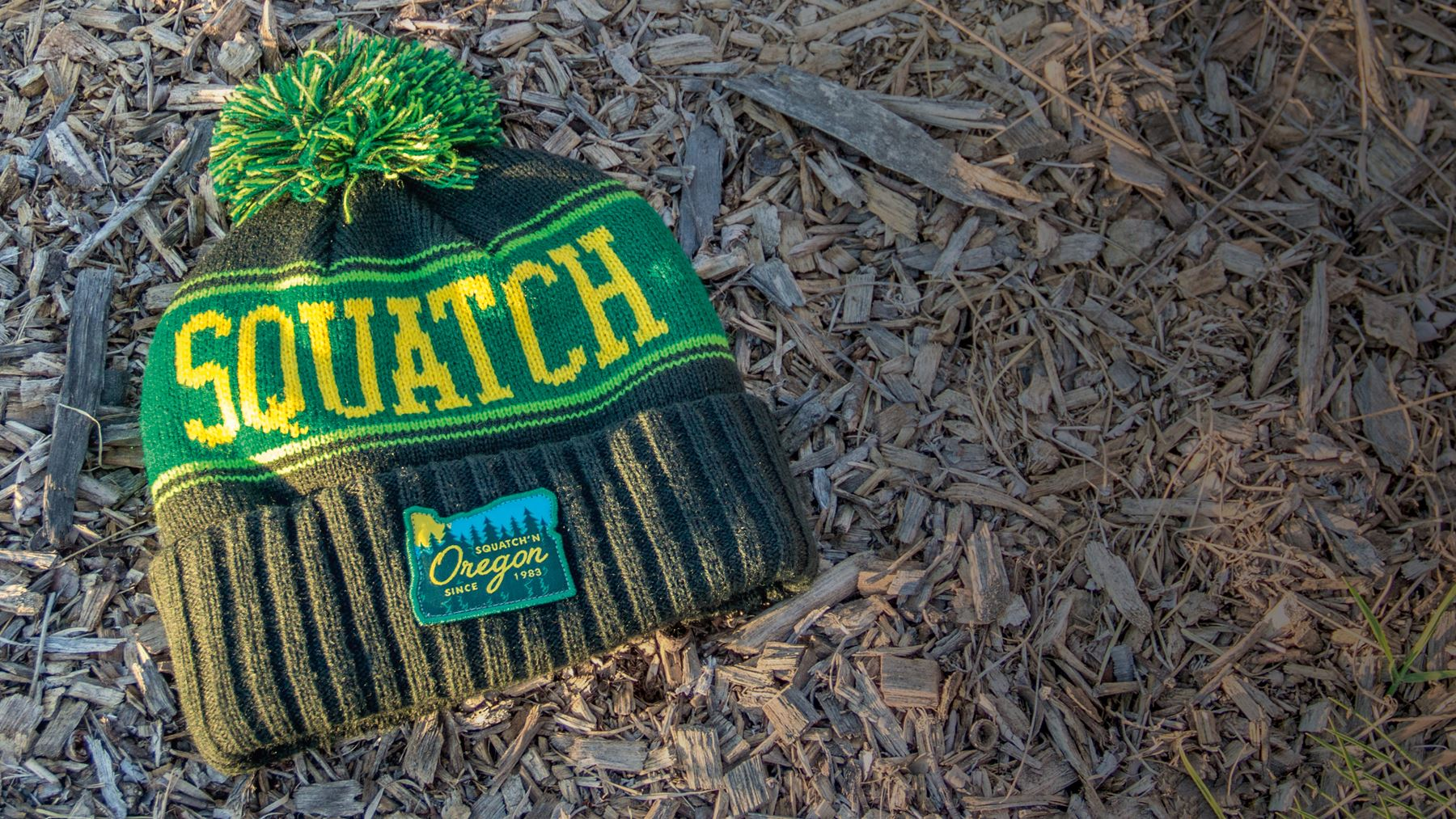 Toboggan / Vintage Knit hat laying on a bed of mulch