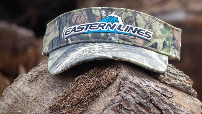 Pukka Low Crown Visor sitting on a log